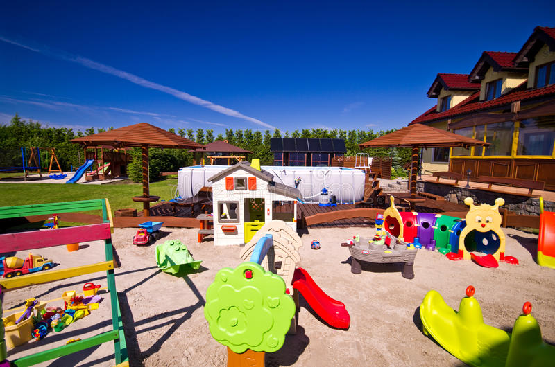 House with children's play area royalty free stock photography
