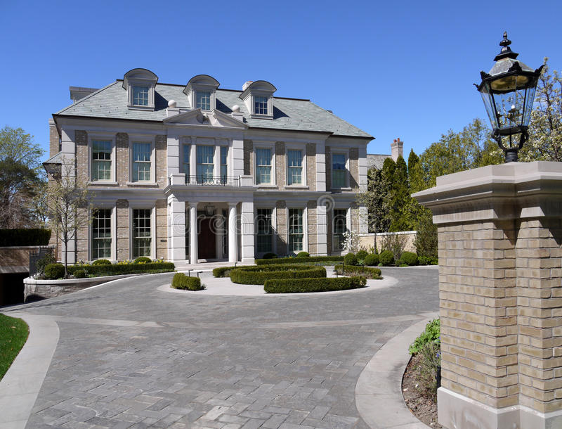 House with circular driveway royalty free stock images