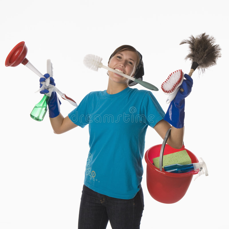 House Cleaning. Young woman with house cleaning tools and supplies stock photos