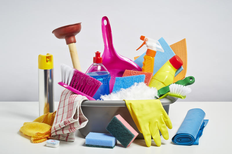 House cleaning products pile on white background. House cleaning products pile. Household chore concept on white background royalty free stock photography