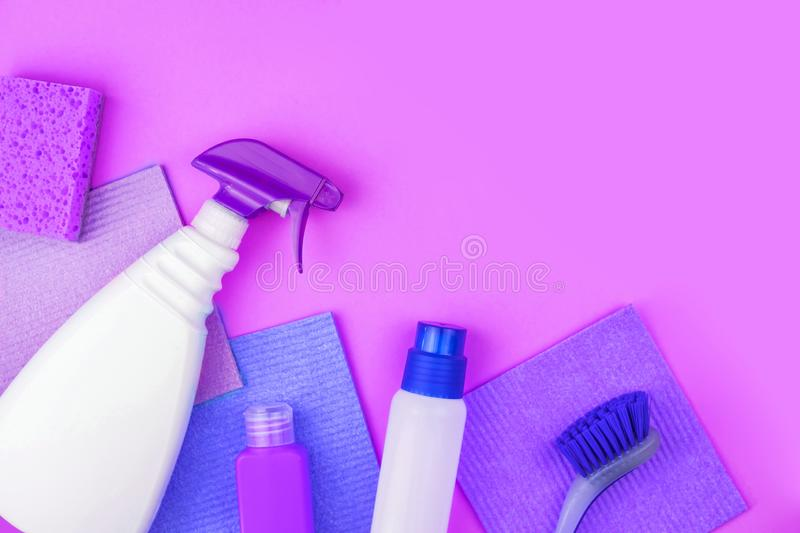 House cleaning products are on purple background. stock photography