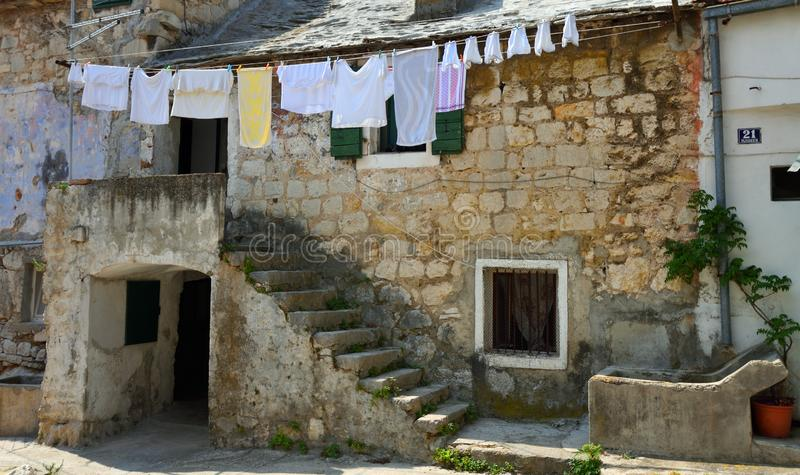 House with clothes drying on washing line in the Veli Varoš district. royalty free stock photography