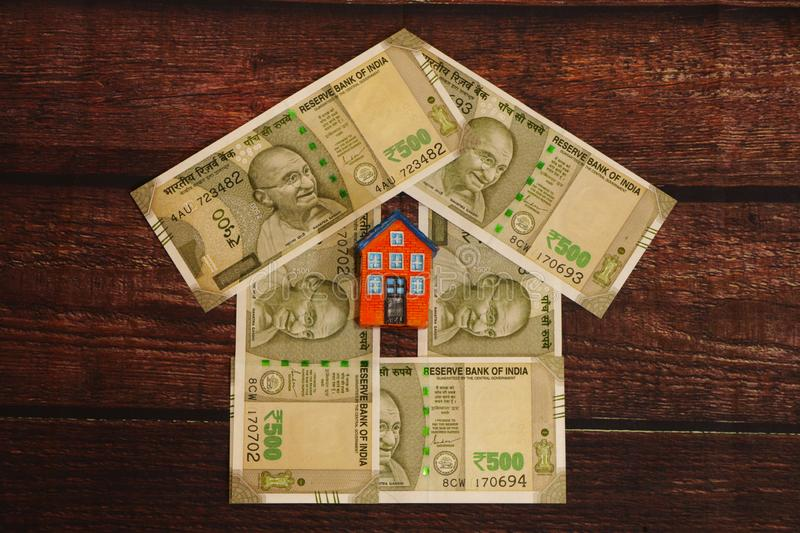 House - Indian Currency. House concept. House made with Indian currency banknotes royalty free stock image