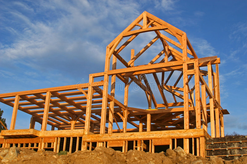 House Construction. A frame of a house under construction against a nice sky stock photography