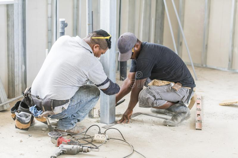 Nice house construction african at work industry. A house construction african at work industry royalty free stock images