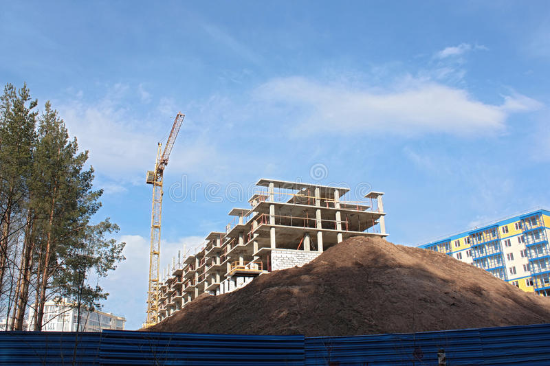 House construction, cran and sand pile. royalty free stock images