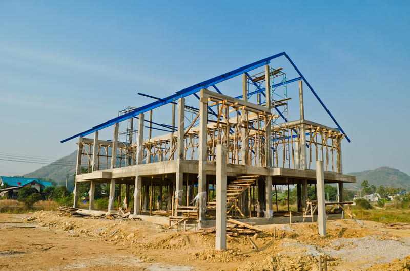 House construction in development. Over blue sky background royalty free stock photos