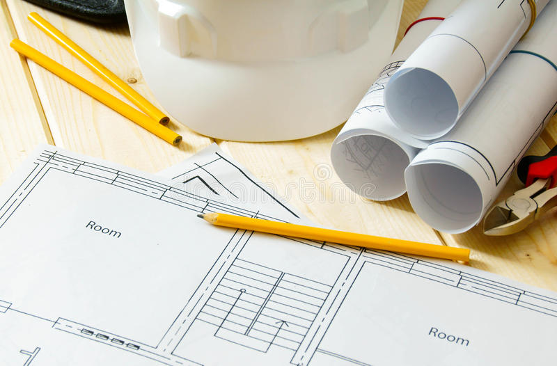 House construction. Drawings for building, helmet royalty free stock image