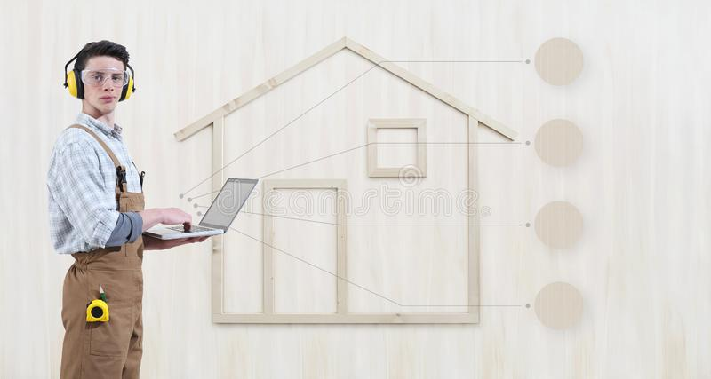 House construction renovation concept handyman carpenter man with laptop computer and infographic list empty symbols icons,. Isolated with the shape of a wooden stock image