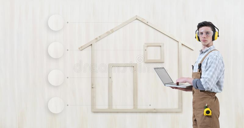 House construction renovation concept handyman carpenter man with laptop computer and infographic list empty symbols icons,. Isolated with the shape of a wooden stock photography