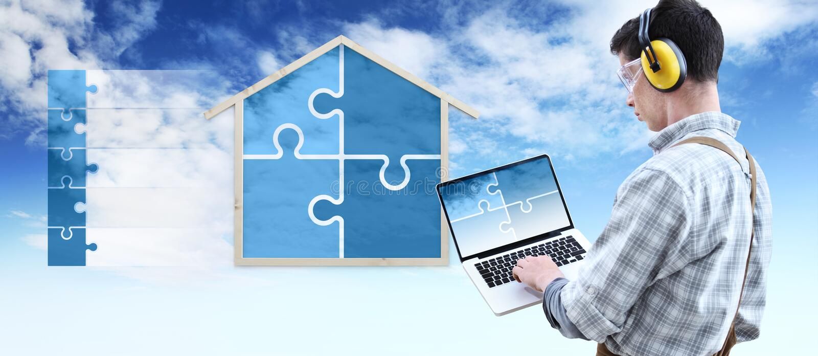 House construction renovation concept handyman carpenter man with laptop computer and puzzle infographic list with the shape of a royalty free stock photo