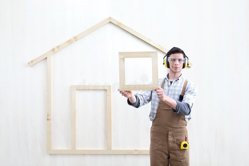 House construction renovation concept handyman carpenter worker man show the model of wooden house stock photos