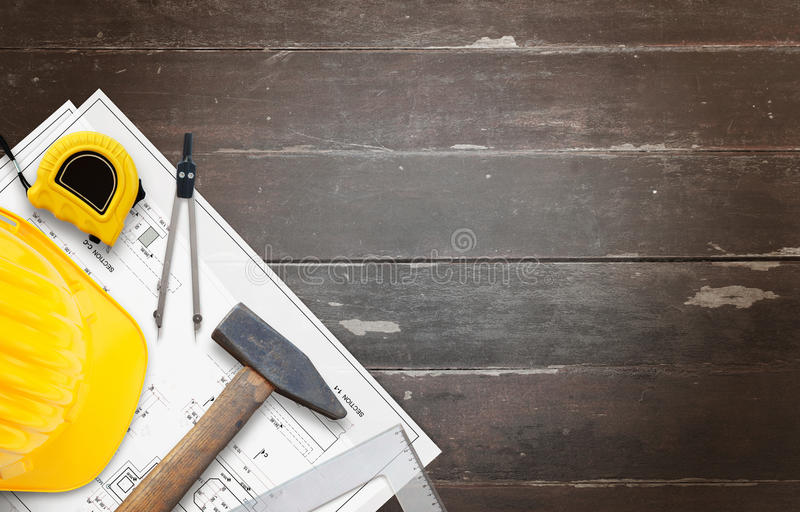 House construction tools on wooden table with free space for text stock photography