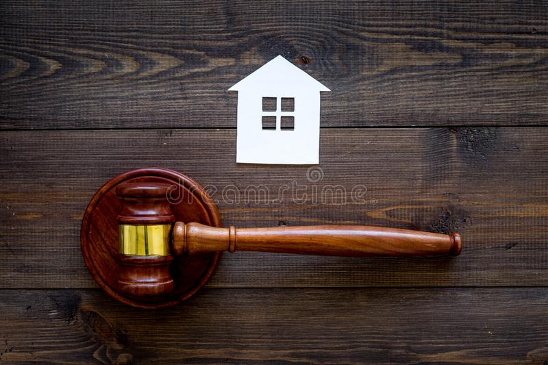 House cutout near judge gavel on dark wooden background top view copy space. Housing law. Property division. Real estate royalty free stock image