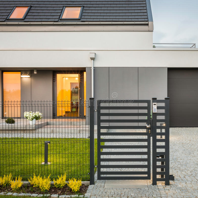 House with decorative fence royalty free stock photography
