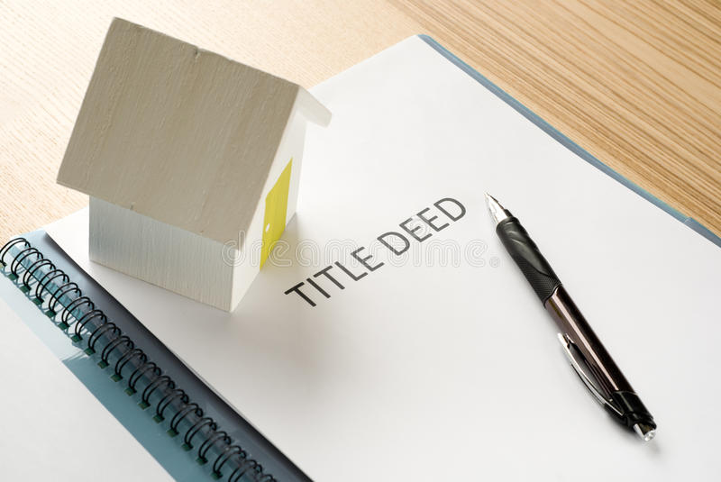 House deed. Documents on table stock image
