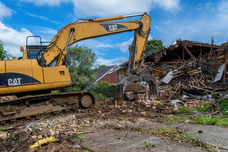 House demolition in Glen Waverley 1. An excavator is demolishing a house in Glen Waverley, suburb near Melbourne, Australia stock image