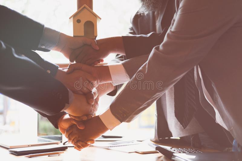 House developer and businessman shaking hands after finishing up. A business meeting. Architect and engineer handshaking after a conference and have agreement royalty free stock image