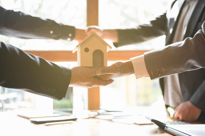 House developer and businessman shaking hands after finishing up. A business meeting. Architect and engineer handshaking after a conference and have agreement stock photos