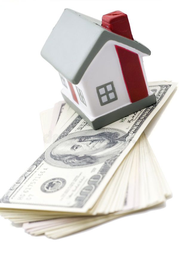 House with dollar. Bills background stock photo