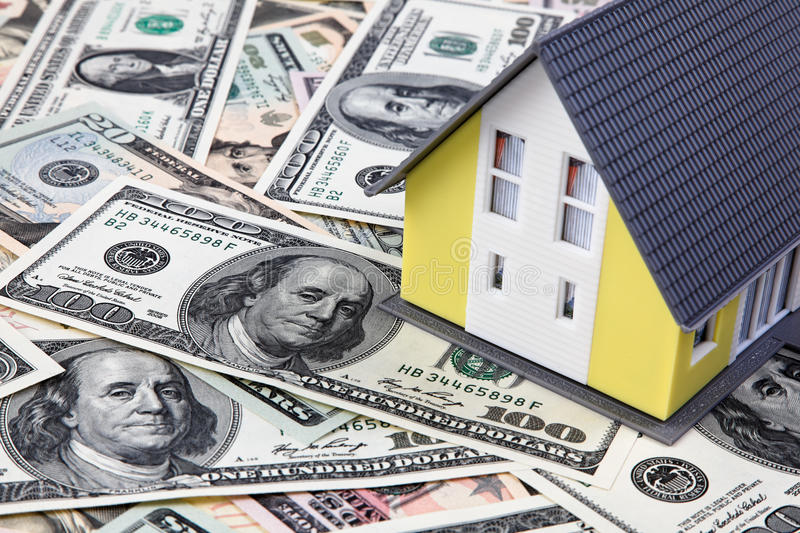House on a dollar banknotes royalty free stock photo