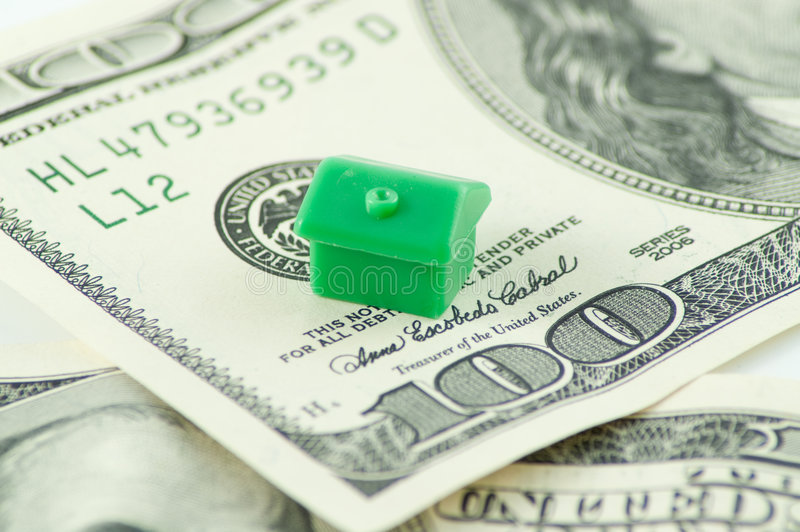 House on dollars. Green toy house on one hundred dollars notes stock photo