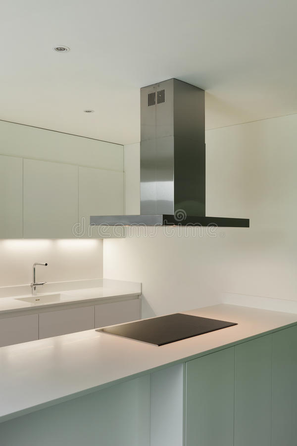 House, domestic kitchen. Interior of new apartment, white domestic kitchen royalty free stock image