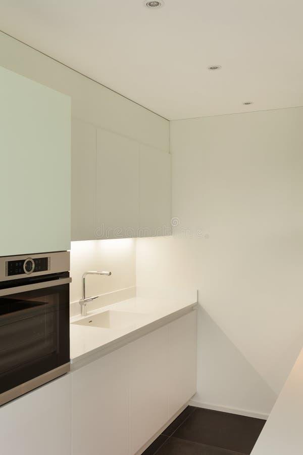House, domestic kitchen. Interior of new apartment, white domestic kitchen, detail royalty free stock photo