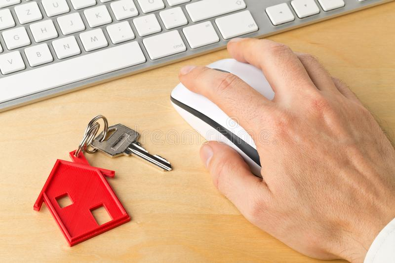 House door key with red house key chain pendant and computer key stock photos