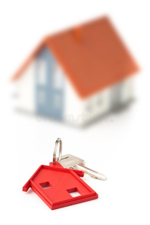 House door key with red house key chain pendant and model house stock images