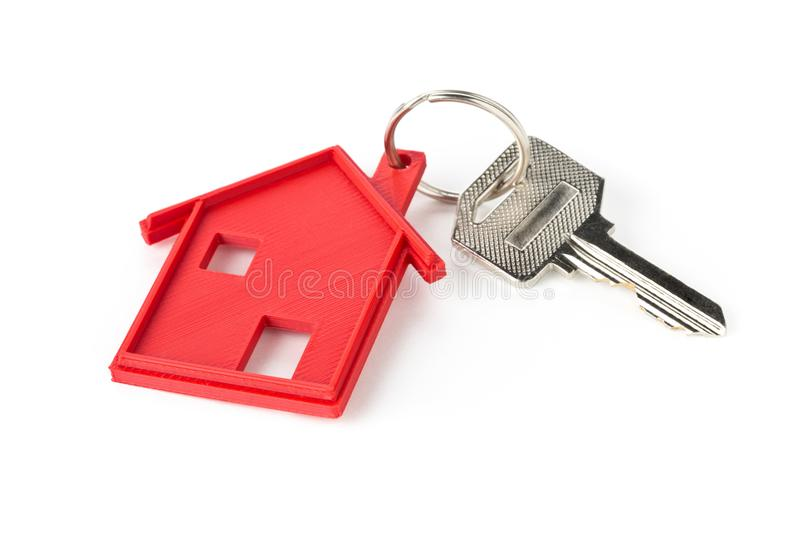 House door key with red house key chain pendant royalty free stock photography