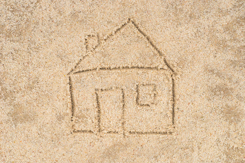 House drawing in sand royalty free stock photo