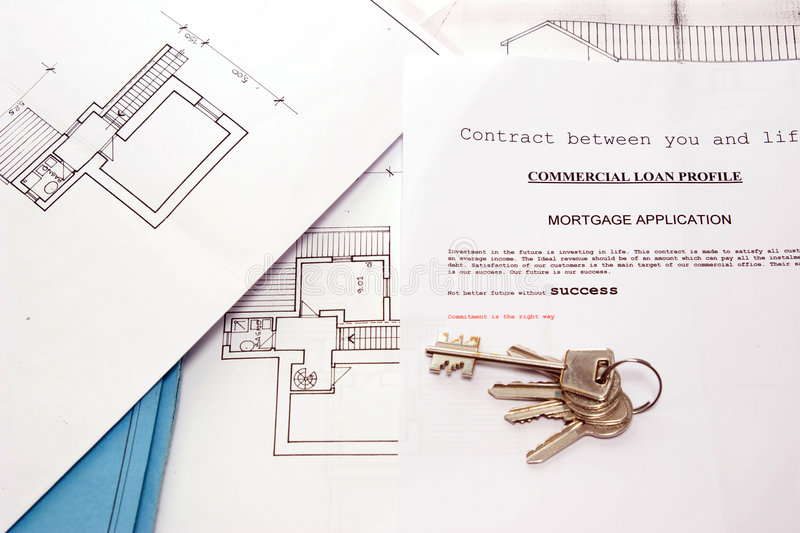 House dream. A project to build a new house on a table of an house builder royalty free stock photography
