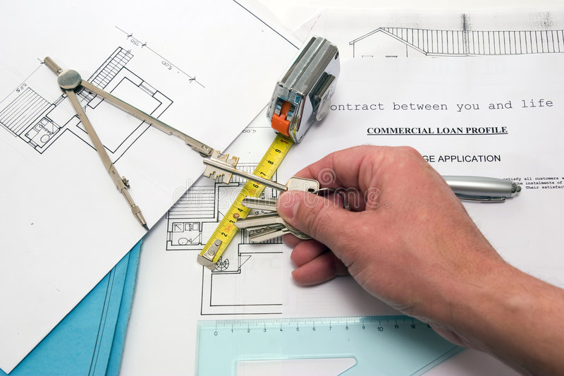 House dream. A project to build a new house on a table of an house builder stock photography