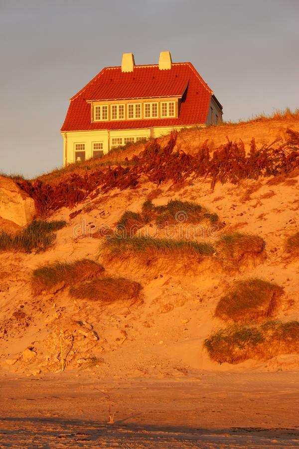 House in the dunes in Denmark, Europe. The marvelous coast of Lokken in evening mood. The marvelous coast of Lokken in evening mood stock photos