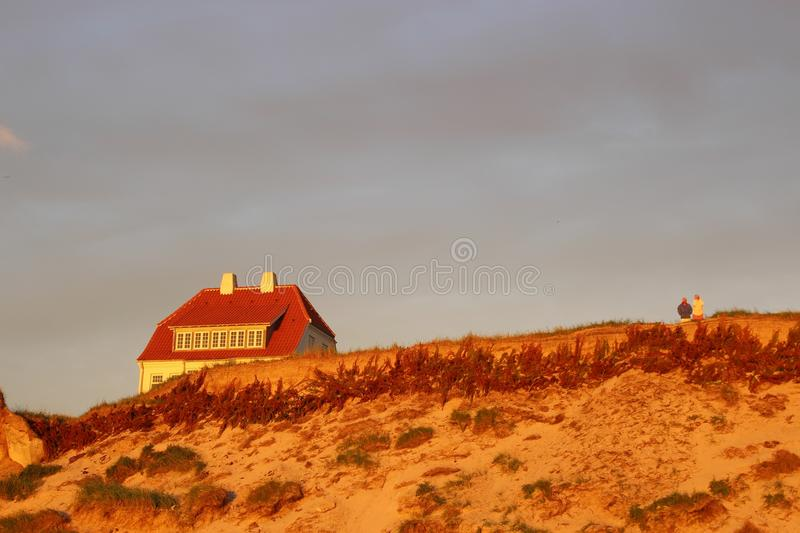 House in the dunes in Denmark, Scandinavia, Europe. The marvelous coast of Lokken in evening light royalty free stock photography