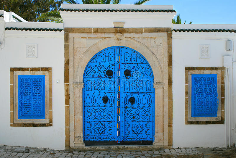 House entrance in tunisian arabic style. This picture represents the house entrance in tunisian arabic style located in beautiful place Sidi Bou Said royalty free stock images