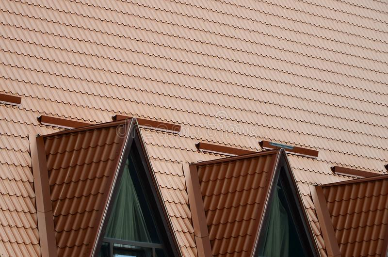 The house is equipped with high-quality roofing of metal tiles. A good example of perfect modern roofing. The building is reliabl. Y protected from adverse stock photography