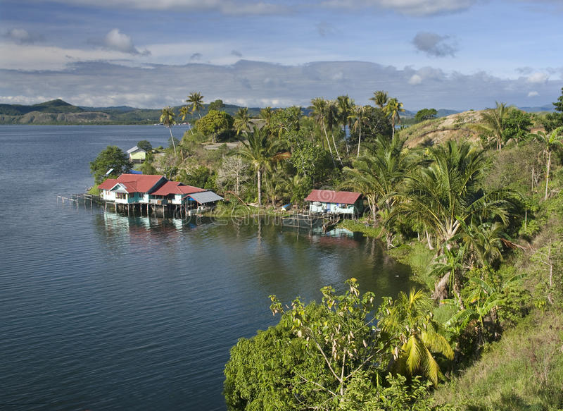 The house established on piles. Lake Sentani, Indonesia stock images