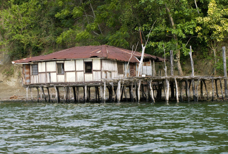 The house established on piles. New Guinea. The house established on piles. Lake Sentani, New Guinea stock images