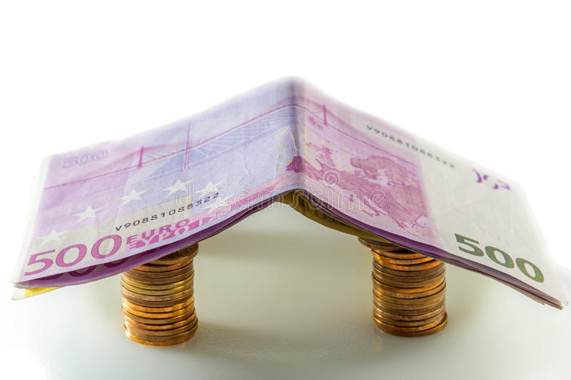 House of euro banknotes. In white background royalty free stock photo