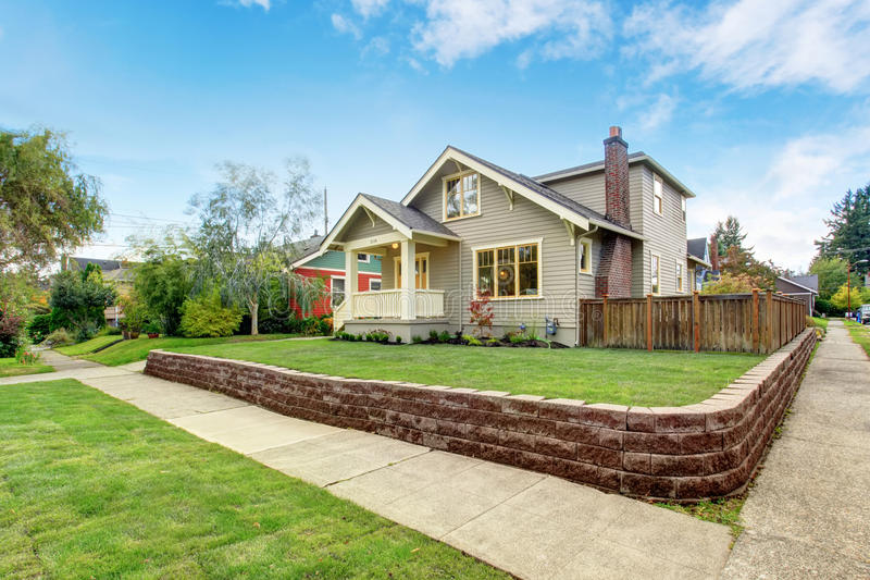House exterior with front yard landscape. And walkways royalty free stock photo