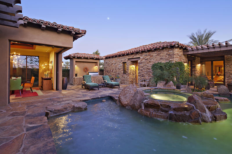 House Exterior with swimming pool and hot tub stock photos