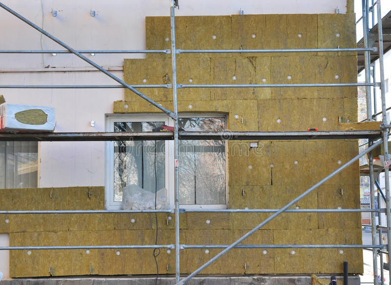 House External Wall Insulation with Fiberglass. Energy Saving Concept. royalty free stock photography