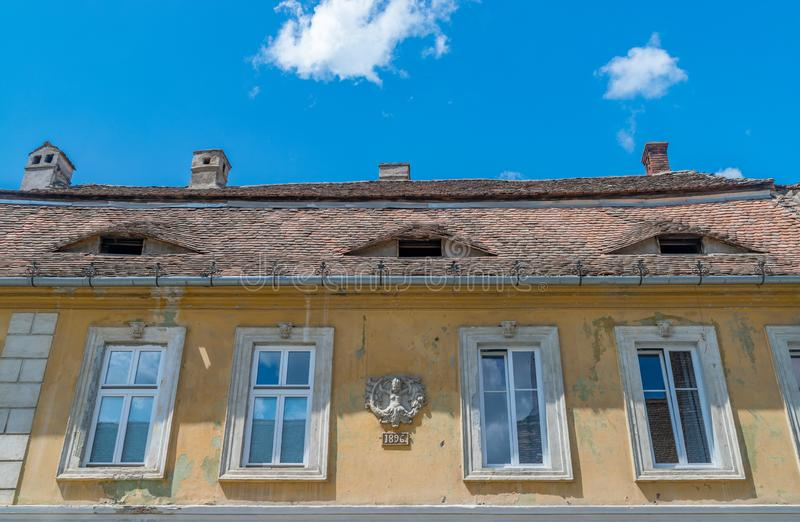 House with eyes on a sunny summer day with blue sky in Sibiu, Romania stock photo