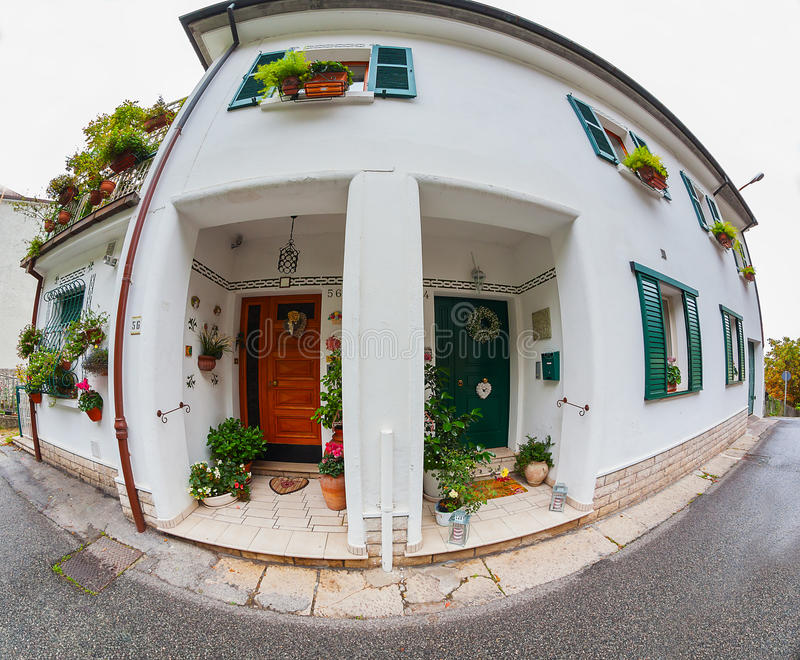 House facade with flowers. Fish eye stock photography