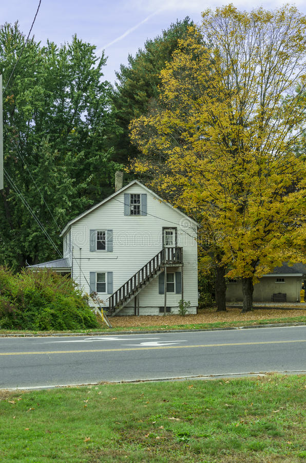 House in fall season on countryside royalty free stock photo