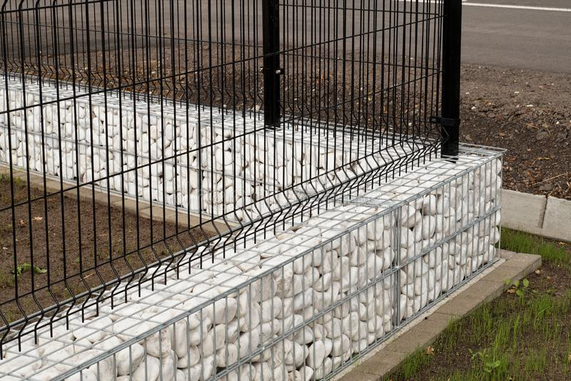 House fence. Corner made of gabions filled with white pebbles. royalty free stock images