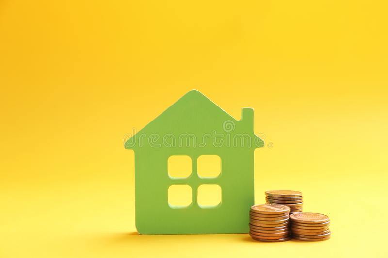 House figure and coins. On color background stock images