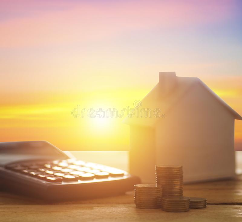 House and finance with calculator with money coin on wood tabl royalty free stock photos